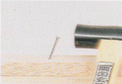 釘の曲がり修正